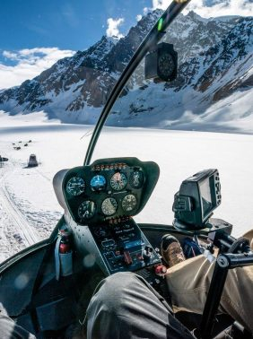 Helicopter to Within The Wild's sled dog camp
