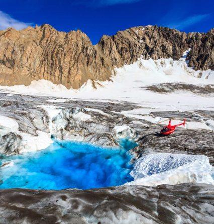 Helicopter on glacier in Alaska for glacier trekking